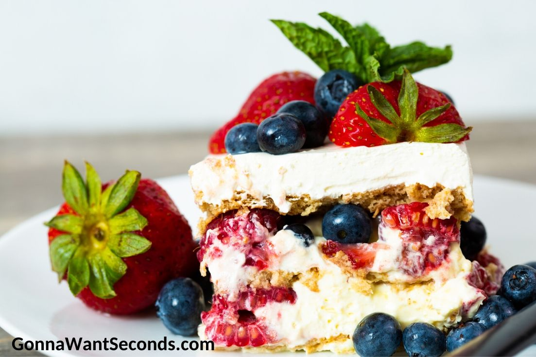 Summer berry icebox cake topped with berries, on a plate
