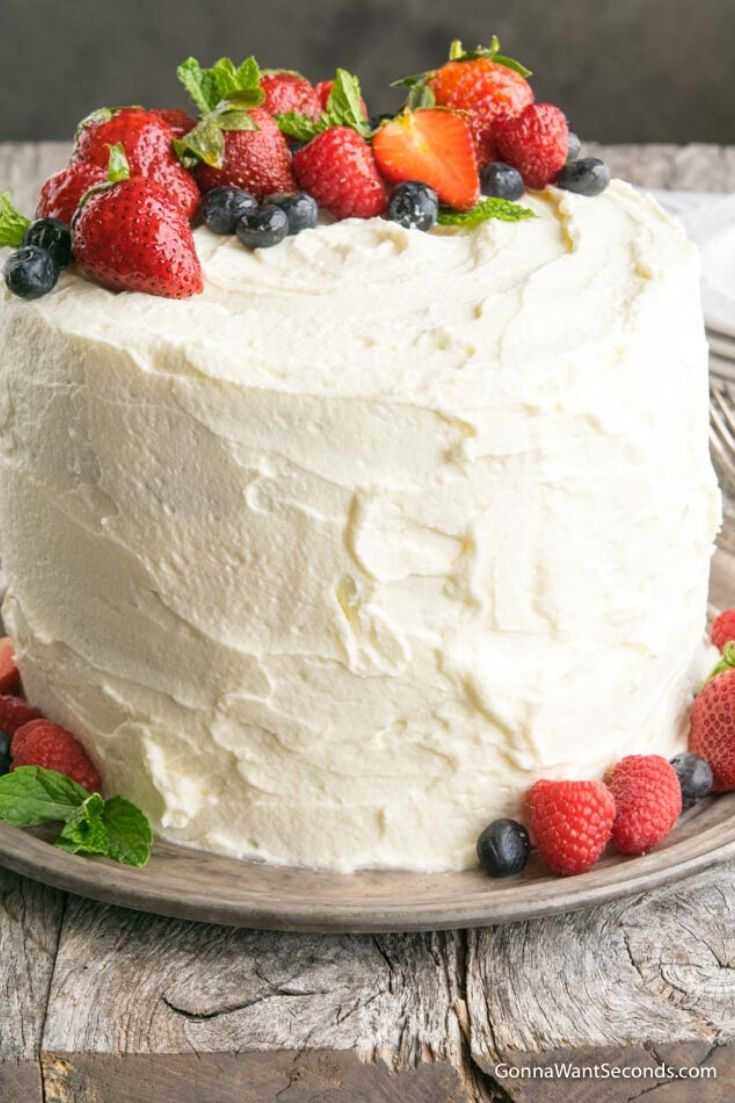 Berry Chantilly Cake topped with fresh berries