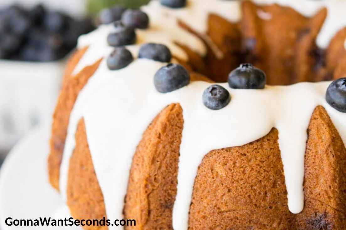 Whole Blueberry Coffee Cake topped with fresh blueberries