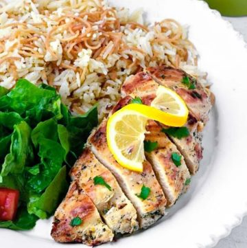 Greek Chicken with rice and lettuce on the side