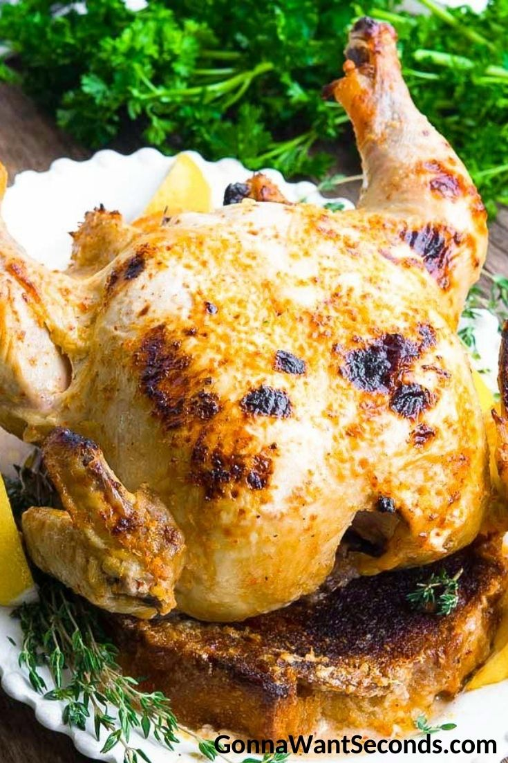 Million dollar chicken with garnish, on a serving plate