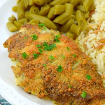 Parmesan crusted chicken with green beans and rice on the side