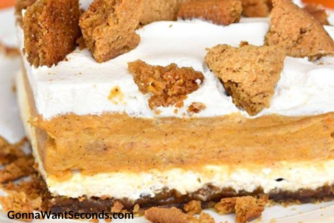 A slice of pumpkin lasagna topped with crushed ginger snaps