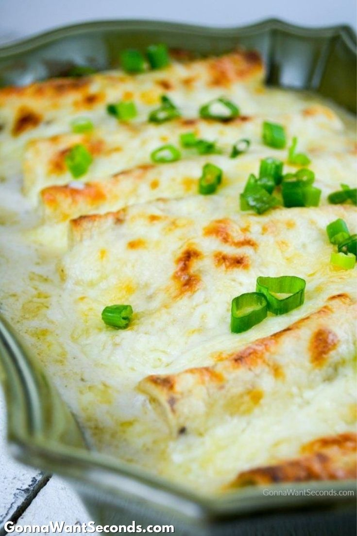White Chicken Enchiladas in a casserole dish
