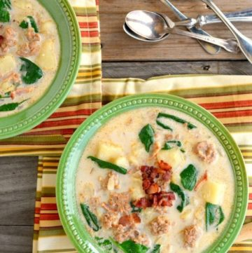 Zuppa Toscana in a green bowl with spoons on the side