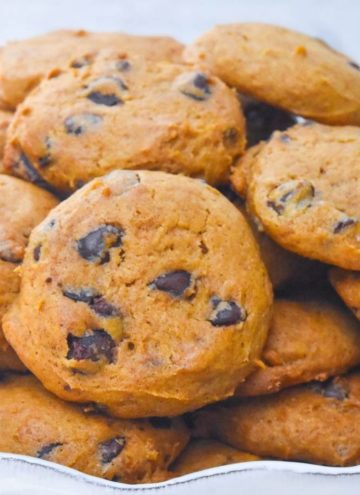 A pile of Pumpkin chocolate chip cookies on a plate