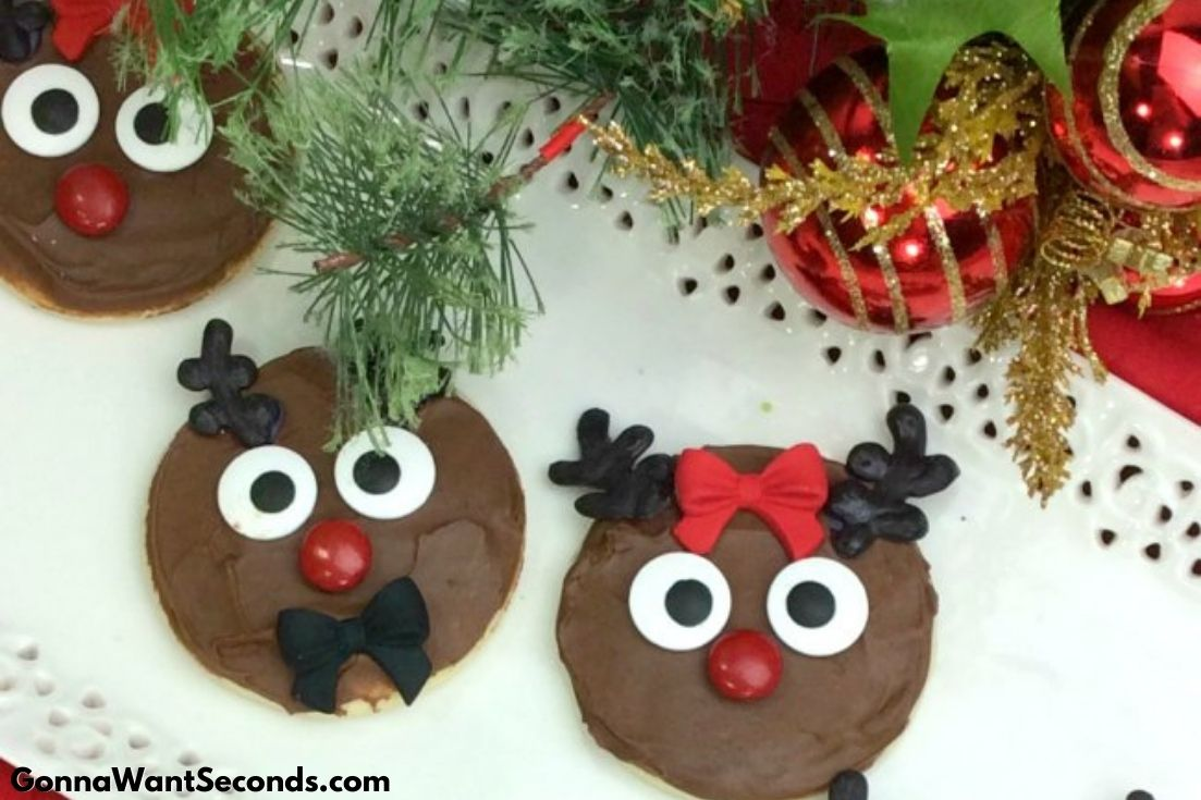 Reindeer Cookies on a serving plate with Christmas decorations