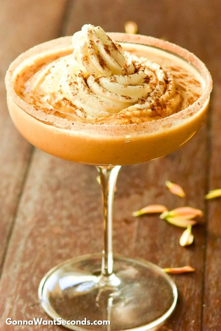 Pumpkin pie martini with whip cream on top in a martini glass