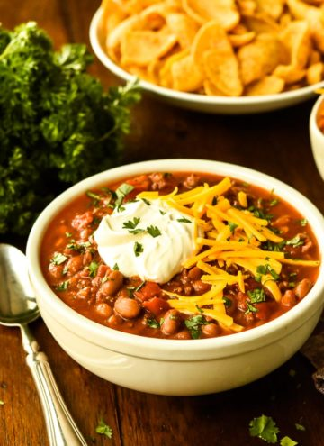 Classic Chili with a dollop of sour cream and shredded cheese on top