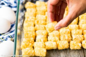 How to make Tater Tot Breakfast Casserole, arranging tater tots in the casserole