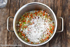 How to make Lemon Chicken Soup, sprinkling flour to sauteed veggies