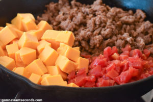 How to make Rotel Dip, mixing all ingredients in the skillet