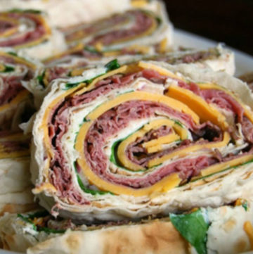 Sliced Rolled Sandwiches in a shallow serving bowl