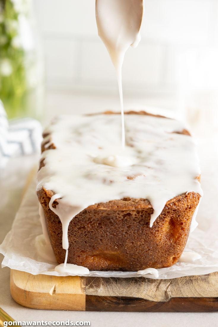 Pouring glaze over Peach Bread