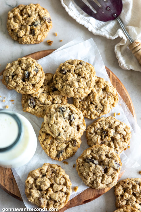 oatmeal raisin cookies with glass of milk, top view