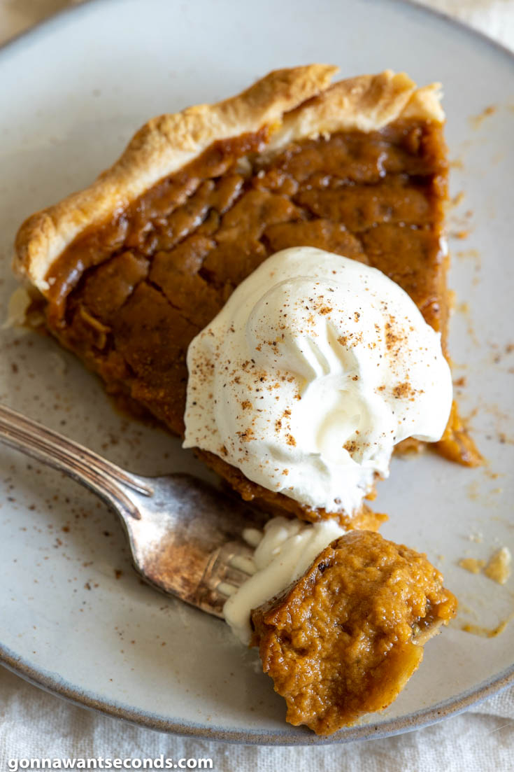 A slice of easy pumpkin pie recipe with fork